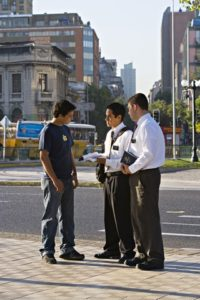 mormon missionaries talking to man in street