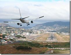 airplane-landing-over-city