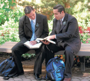 Mormon Missionaries Reading Scriptures