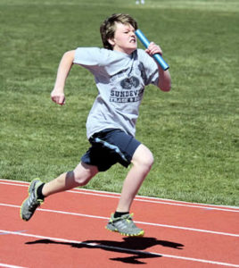 boy running in race