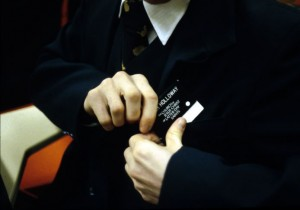 Missionary putting on name tag