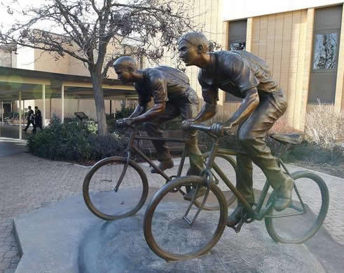 missionaries on bikes bronze statue