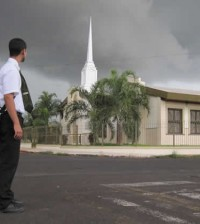missionary in front of lds church building