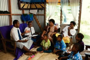 Missionaries testifying to a family in Fiji