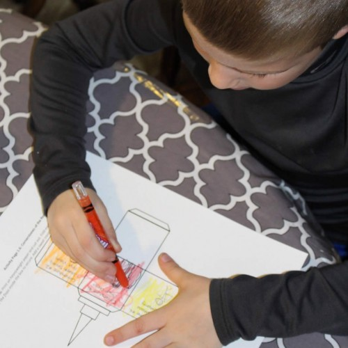 boy coloring cutout of church