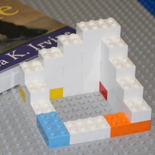 lego building with four cornerstones