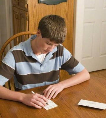 young man paying tithing