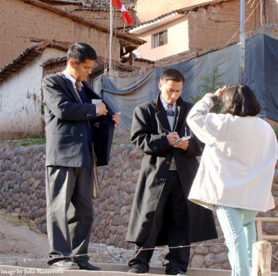 mormon missionaries talking to a woman